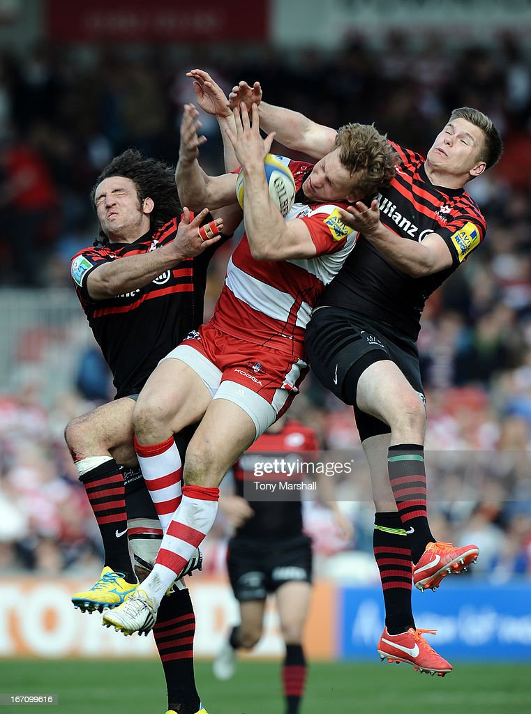 Billy Twelvetrees of Gloucester jumps for the high ball with Jacques Burger (left) and Owen Farrell (right) of Saracens during the Aviva Premiership match between Gloucester and Saracens at Kingsholm Stadium on April 20, 2013 in Gloucester, England.