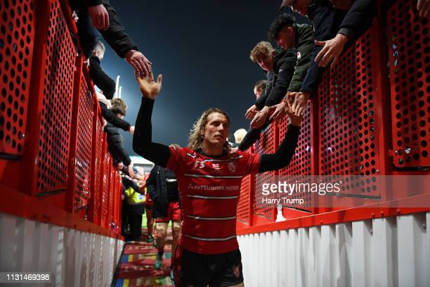 Billy Twelvetrees of Gloucester Rugby celebrates by high fiving the fans after the match during the Gallagher Premiership Rugby match between...