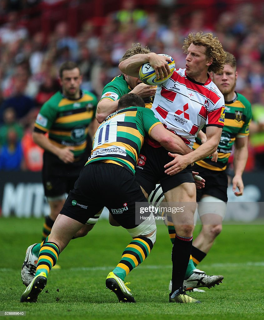 Billy Twelvetrees of Gloucester Rugby is tackled by George North of Northampton Saints during the Aviva Premiership match between Gloucester Rugby and Northampton Saints at Kingsholm on May 07, 2016 in Gloucester, England.