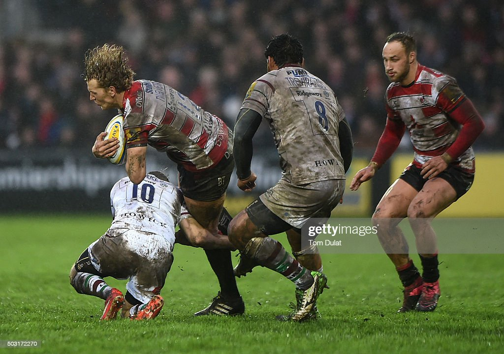 Billy Twelvetrees of Gloucester Rugby is tackled during the Aviva Premiership match between Gloucester Rugby and London Irish at Kingsholm Stadium on January 2, 2016 in Gloucester, England. (Photo by Tom Dulat/Getty Images).