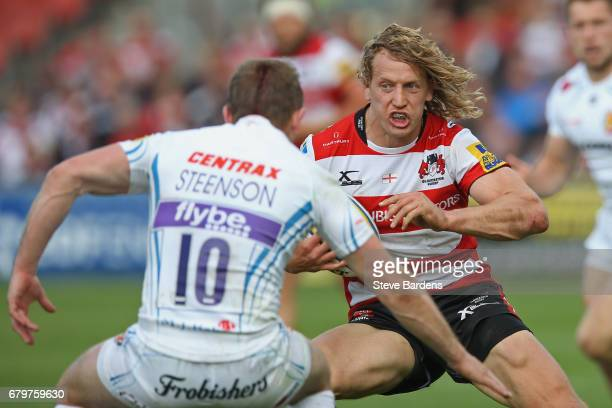Billy Twelvetrees of Gloucester Rugby takes on Gareth Steenson of Exeter Chiefs during the Aviva Premiership match between Gloucester Rugby and...