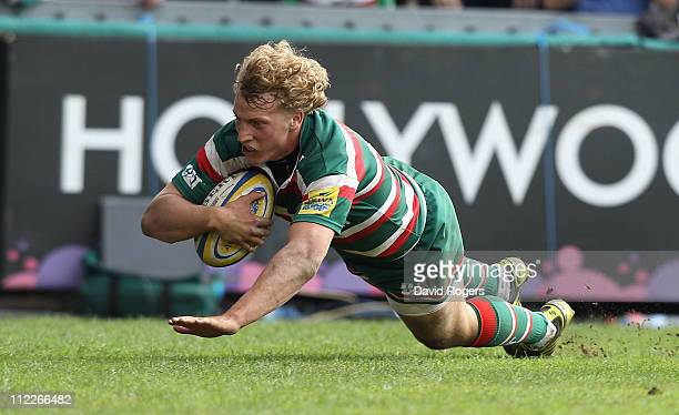 Billy Twelvetrees of Leicester dives over for a try during the Aviva Premiership match between Leicester Tigers and Gloucester at Welford Road on...
