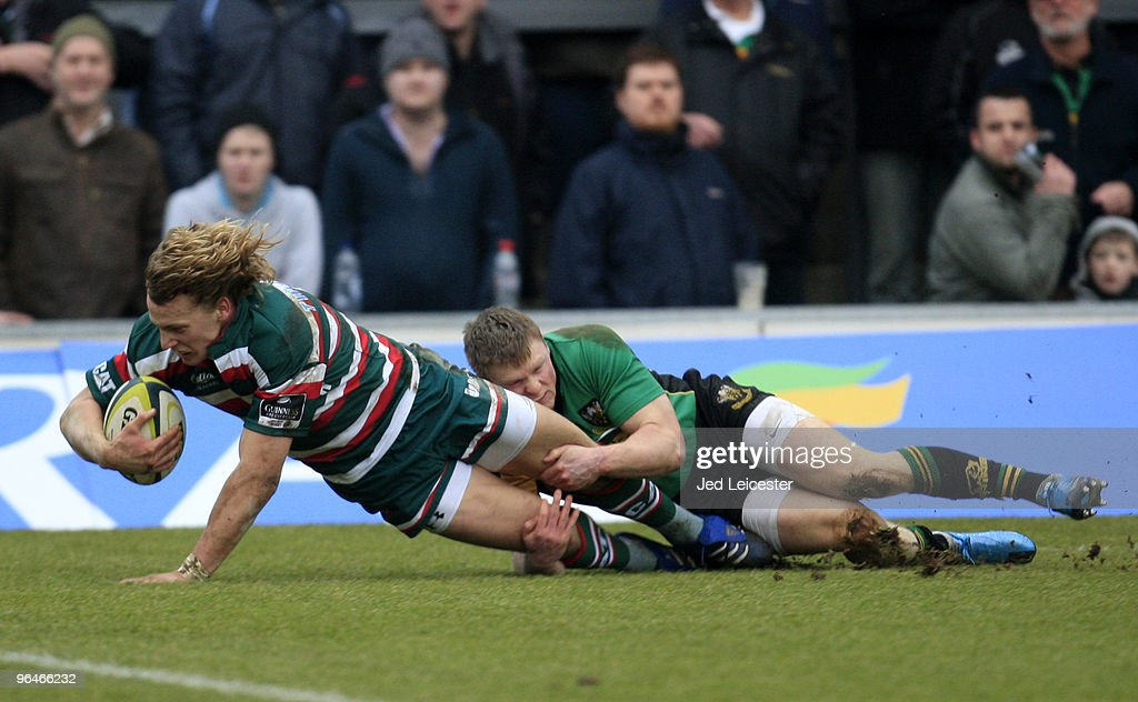 Billy Twelvetrees of Leicester Tigers is tackled by Chris Ashton of Northampton Saints as he stretches over to score a try during the LV Anglo Welsh Cup match between Northampton Saints and Leicester Tigers at the Sixfields Stadium, on February 6, 2010 in Northampton, England.