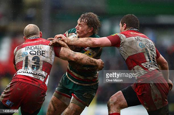 Billy Twelvetrees of Leicester Tigers is tackled by Mike Tindall of Gloucester during the Aviva Premiership match between Leicester Tigers and...