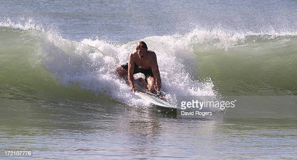 Billy Twelvetrees of the British and Irish Lions rides a wave as they take part in surfing on July 2 2013 in Noosa Australia