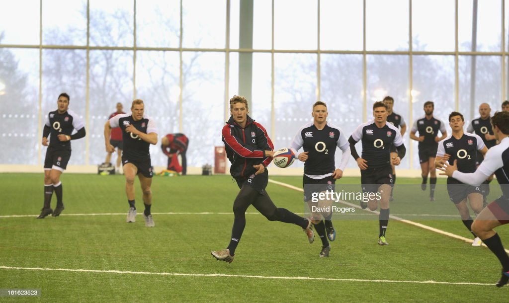 Billy Twelvetrees passes the ball during the England training session held at St Georges Park on February 13, 2013 in Burton-upon-Trent, England.
