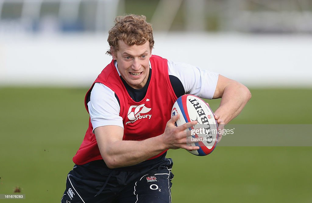 Billy Twelvetrees runs with the ball during the England training session held at St Georges Park on February 14, 2013 in Burton-upon-Trent, England.