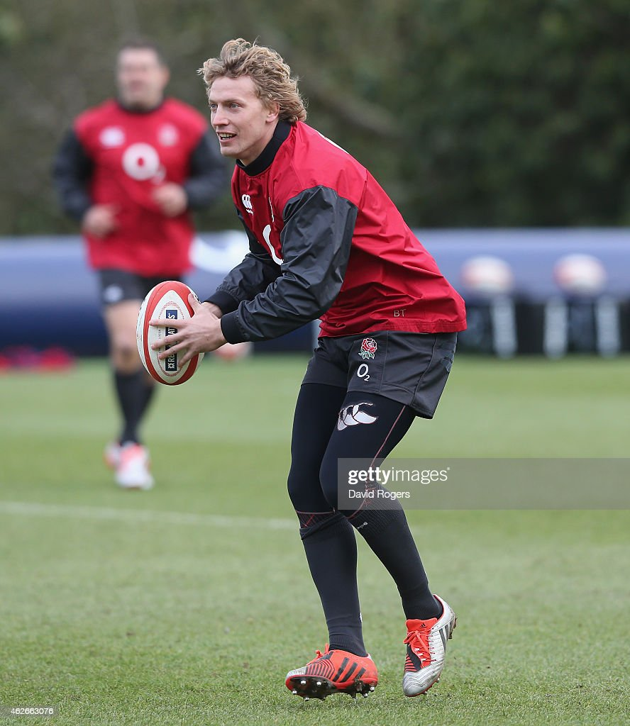 Billy Twelvetrees runs with the ball during the England training session held at Pennyhill Park on February 2, 2015 in Bagshot, England.