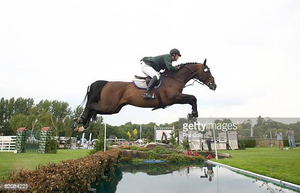 Billy Twomey riding Je T'aime Flamenco clears the water jump during the Old Lodge Queen Elizabeth II Cup on July 26 in Hickstead England