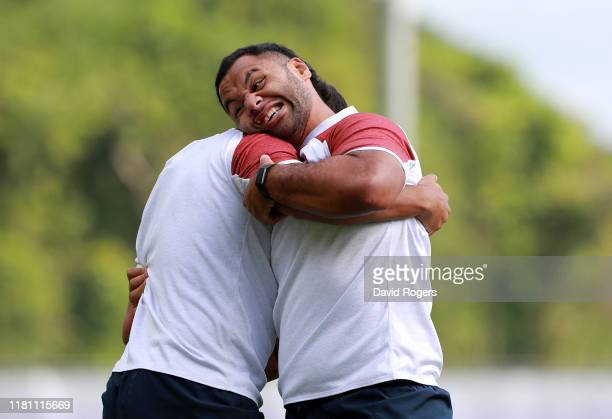 Billy Vunipola grapples with team mate Lewis Ludlam during the England training session held Jissouji multi purpose ground on October 15 2019 in...