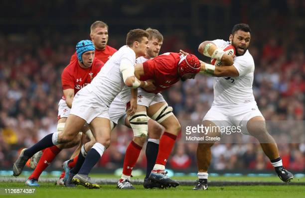 Billy Vunipola of England breaks away from Cory Hill of Wales during the Guinness Six Nations match between Wales and England at Principality Stadium...