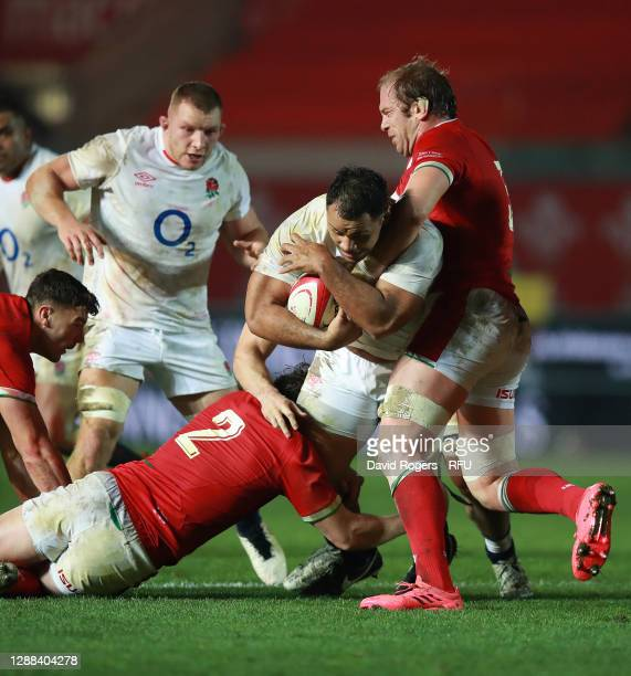 Billy Vunipola of England is tackled by Alun Wyn Jones and Ryan Elias during the Quilter International match between Wales and England as part of the...