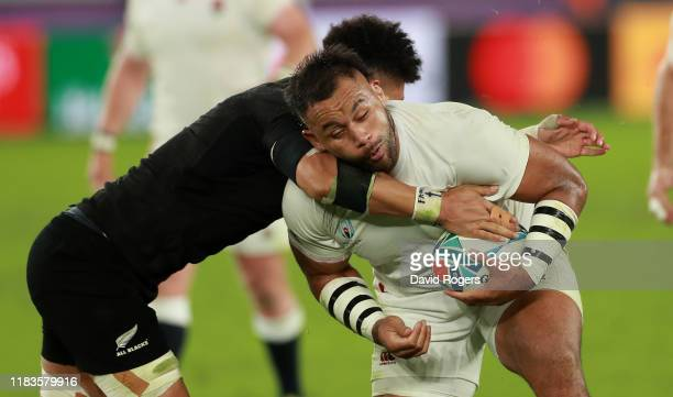 Billy Vunipola of England is tackled by Ardie Savea during the Rugby World Cup 2019 SemiFinal match between England and New Zealand at International...