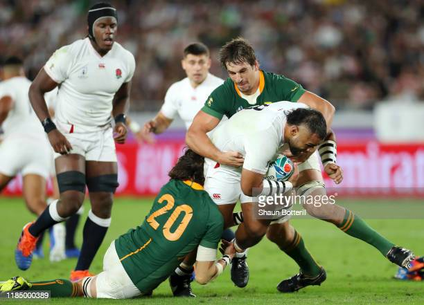 Billy Vunipola of England is tackled by Eben Etzebeth and Franco Mostert of South Africa during the Rugby World Cup 2019 Final between England and...