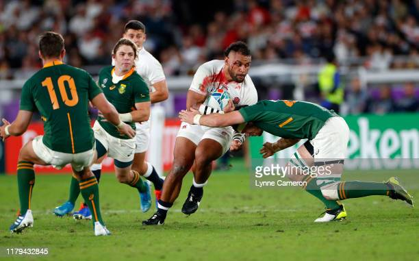 Billy Vunipola of England is tackled by Eben Etzebeth of South Africa during the Rugby World Cup 2019 Final between England and South Africa at...