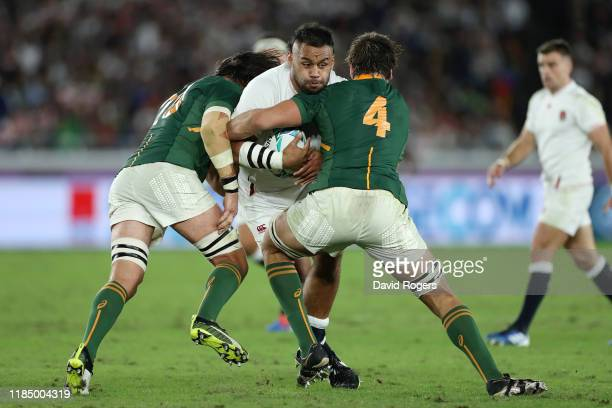 Billy Vunipola of England is tackled by Franco Mostert and Eben Etzebeth of South Africa during the Rugby World Cup 2019 Final between England and...