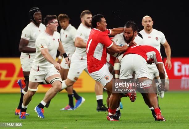 Billy Vunipola of England is tackled by Leon Fukofuka Zane Kapeli of Tonga during the Rugby World Cup 2019 Group C game between England and Tonga at...