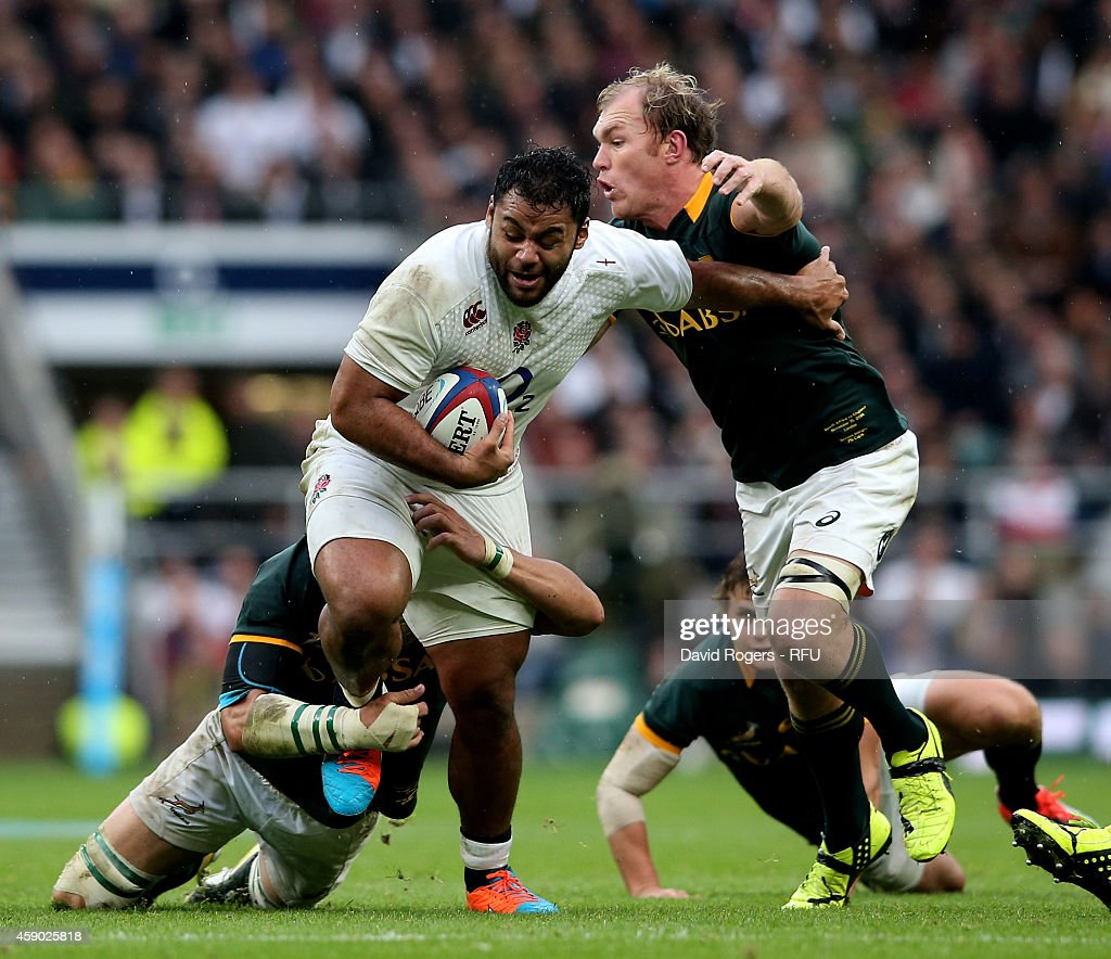 Billy Vunipola of England is tackled by Schalk Burger of South Africa during the QBE Intenational match between England and South Africa at Twickenham Stadium on November 15, 2014 in London, England.