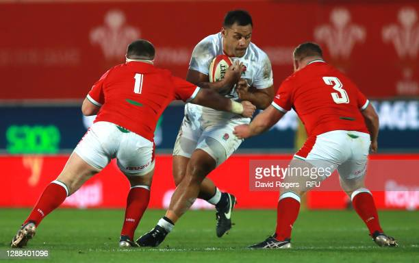 Billy Vunipola of England is tackled by Wyn Jones and Samson Lee during the Quilter International match between Wales and England as part of the...