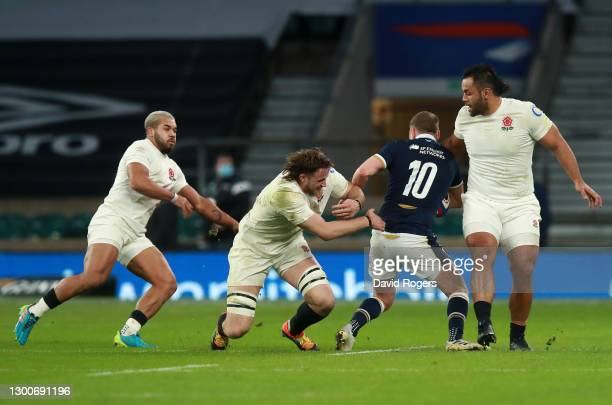 Billy Vunipola of England performs a high tackle on Finn Russell of Scotland resulting in a yellow card during the Guinness Six Nations match between...