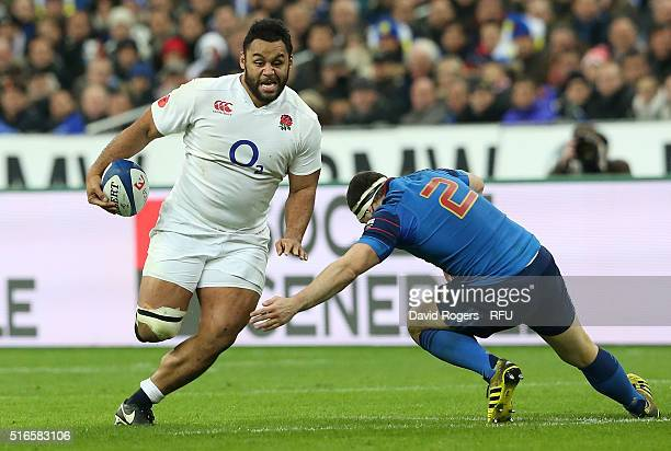 Billy Vunipola of England takes on Guilhem Guirado during the RBS Six Nations match between France and England at the Stade de France on March 19...