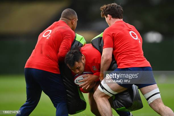 Billy Vunipola of England takes on Kyle Sinckler and Tom Curry of England during an England training session at The Lensbury on February 03, 2021 in...