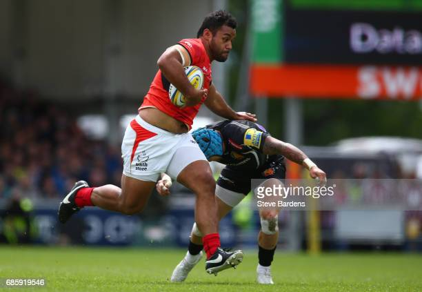 Billy Vunipola of Saracens hands off Jack Nowell of Exeter Chiefs during the Aviva Premiership semi final match between Exeter Chiefs and Saracens at...