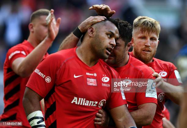Billy Vunipola of Saracens is congratulated after scoring his try during the Champions Cup Final match between Saracens and Leinster at St James Park...