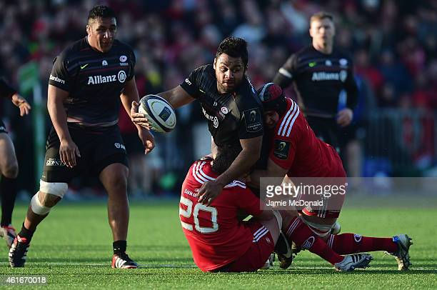 Billy Vunipola of Saracens is tackled by Ernst Joubert of Munster during the European Rugby Champions Cup match between Saracens and Munster Rugby at...