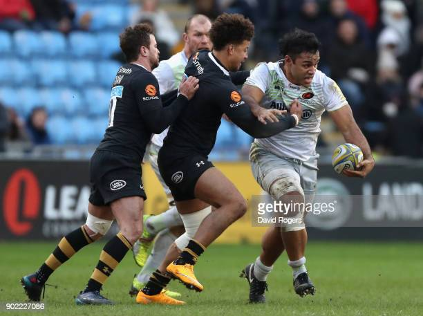 Billy Vunipola of Saracens is tackled by Guy Armitage and Danny Cipriani during the Aviva Premiership match between Wasps and Saracens at The Ricoh...