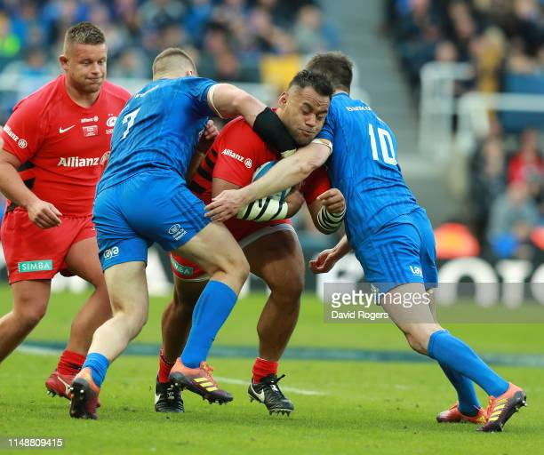 Billy Vunipola of Saracens is tackled by Jonathan Sexton and Sean O'Brien during the Champions Cup Final match between Saracens and Leinster at St....