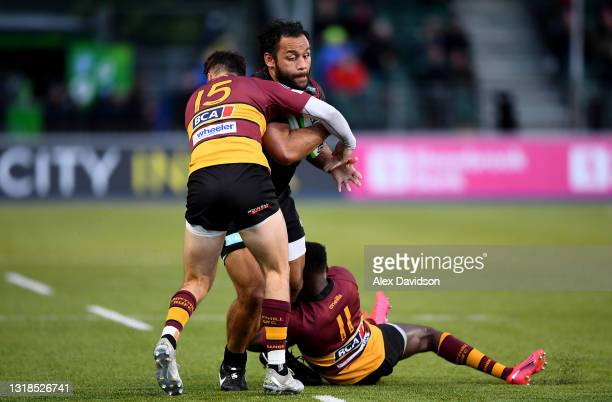 Billy Vunipola of Saracens is tackled by Spencer Sutherland and Cameron Anderson of Ampthill during the Greene King IPA Championship match between...