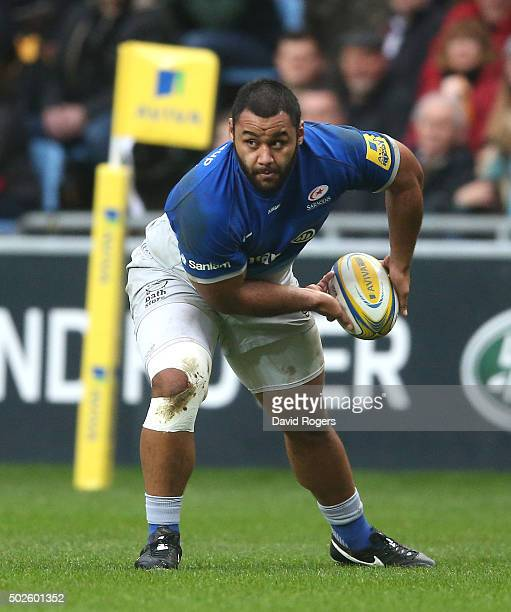 Billy Vunipola of Saracens passes the ball during the Aviva Premiership match between Wasps and Saracens at The Ricoh Arena on December 27 2015 in...