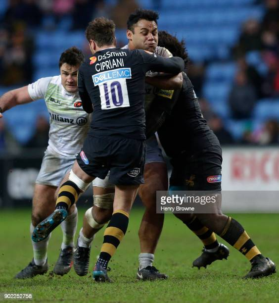Billy Vunipola of Saracens tackled by Danny Cipriani and Ashley Johnson of Wasps during the Aviva Premiership match between Wasps and Saracens at The...