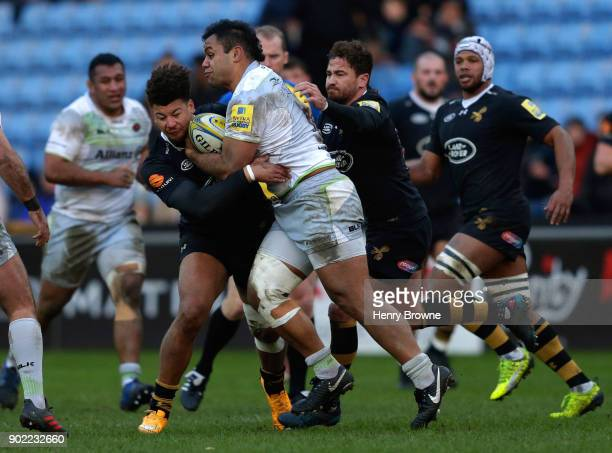 Billy Vunipola of Saracens tackled by Guy Armitage of Wasps and Danny Cipriani of Wasps during the Aviva Premiership match between Wasps and Saracens...