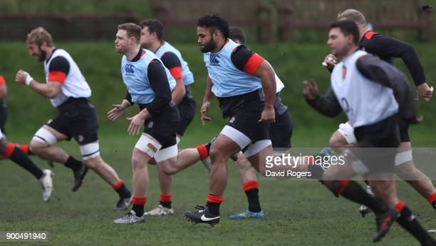 Billy Vunipola sprints with team mate Sam Simmonds during the England training session at Brighton College on January 2 2018 in Brighton England