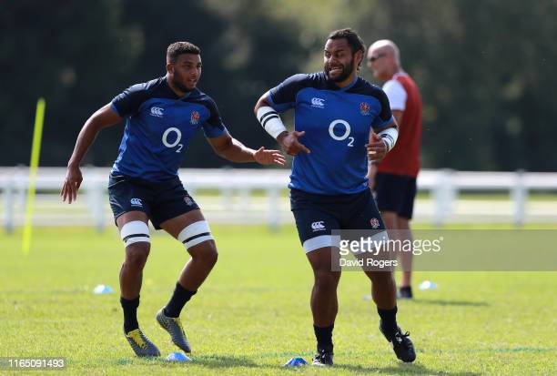 Billy Vunipola warms up with team mate Lewis Ludlam during the England training session on July 30 2019 in Treviso Italy