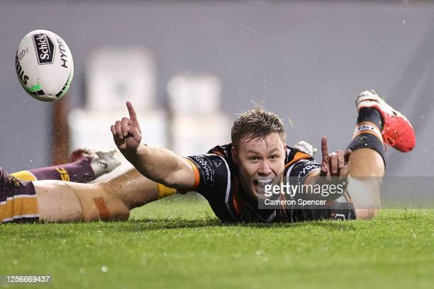 Billy Walters of the Wests Tigers celebrates scoring a try during the round 10 NRL match between the Wests Tigers and the Brisbane Broncos at...