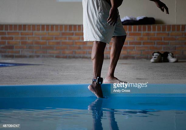 Billy Wheelock checks the temperature of the water ankle monitor attached before taking a swim the first swim over 21years at his fiancee's apartment...