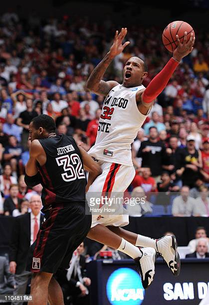 Billy White of the San Diego State Aztecs shoots over Rahlir Jefferson of the Temple Owls during the third round of the 2011 NCAA men's basketball...