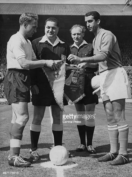 Billy Wright and Armando Segato the England and Italian captains exchange pennants before the international match at Wembley Stadium 6th May 1959 The...