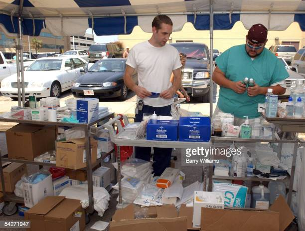 Biloxi Regional Medical Center employees Brian Cunningham and Michael Pernell stock supplies in an outdoor clinic September 2 2005 in Biloxi...