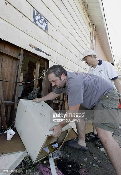TO GO WITH AFP STORY USinsuranceweatherAllstateStateFarm In this 30 August 2005 file photo residents salvage a file cabinet with insurance papers...