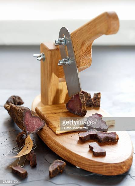 Biltong Being Sliced by Cutter