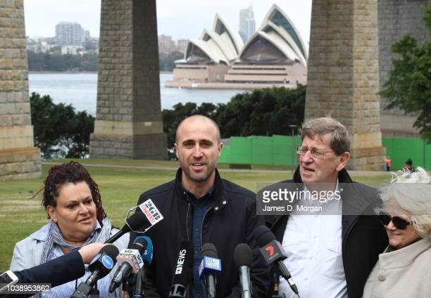 Family members of Australian filmmaker James Ricketson appear in front of media underneath the Harbour Bridge to talk about their first night with...