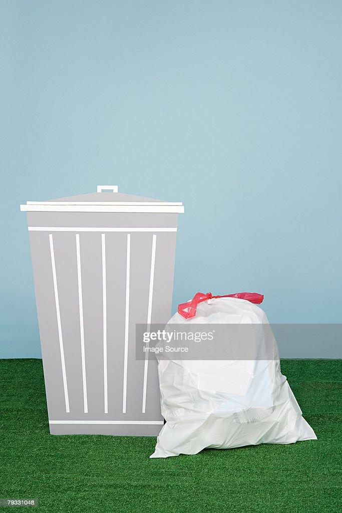 A bin and rubbish bag  : Stock Photo