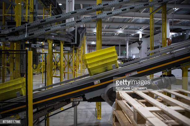 A bin filled with inbound merchandise move along a conveyor belt at the Amazoncom MPX5 fulfillment center on November 17 2017 in Castel San Giovanni...