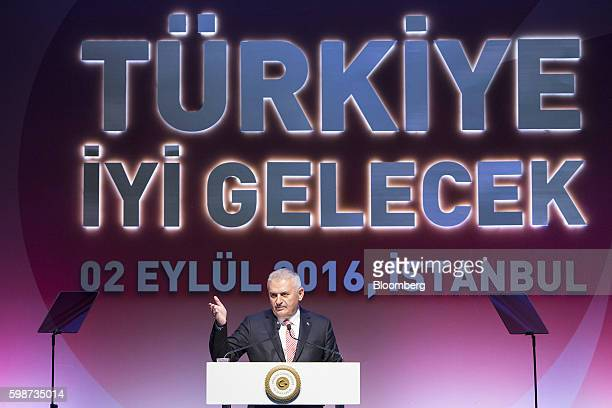 Binali Yildirim Turkey's prime minister gestures as he speaks during the BloombergHT investor conference in Istanbul Turkey on Friday Sept 2 2016...