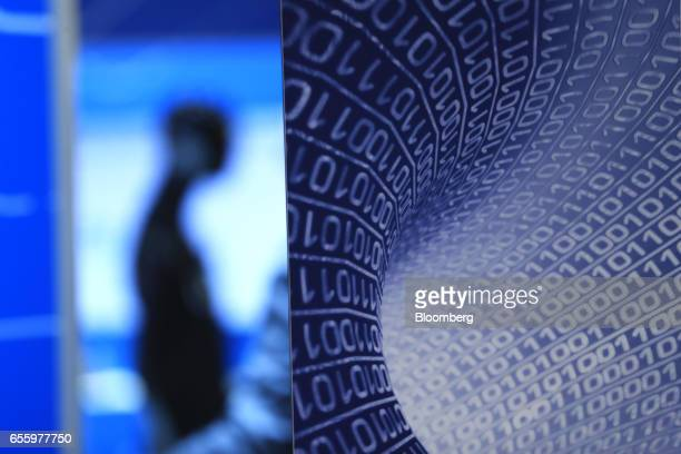 A binary code design decorates the wall of the Fraunhofer IIS pavilion at the CeBIT 2017 tech fair in Hannover Germany on Tuesday March 21 2017...