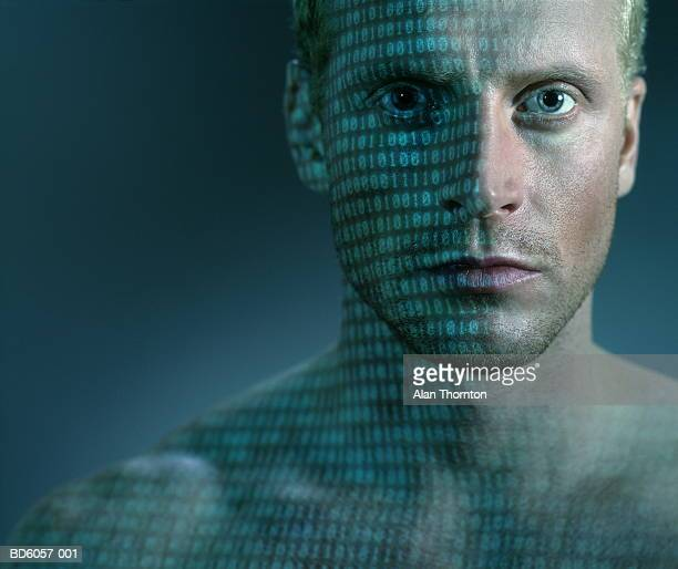 Binary code projected onto man's face and chest, close-up